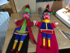 Two Mr Punch's having their costumes made